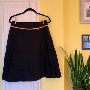BLACK SKIRT WITH PINK BOW